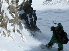 Rock Climbing Photo: Ripping a turn lower down with slough in the backg...
