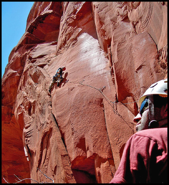 Finishing the crux of the second pitch of Arch Enemy, while Chris belays & soaks up the scenery on his first visit to Sedona. An exciting and very exposed pitch.  Photo by Manny R.