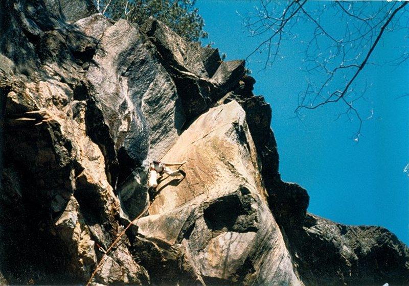 First assent? Climbed on gear and pins (the pins keep falling out). Note the lack of bolts and draws on the crag. Tom Armstrong climbing.