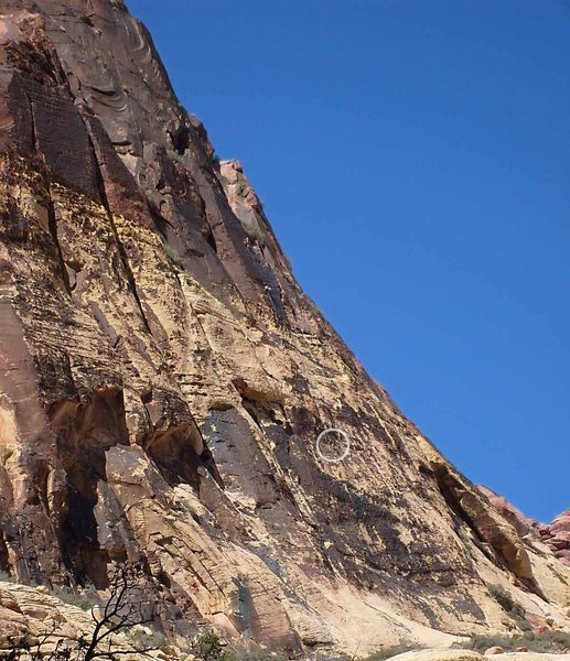 The upper climber is leading the varnished third pitch.  The circled climber is following pitch 2.