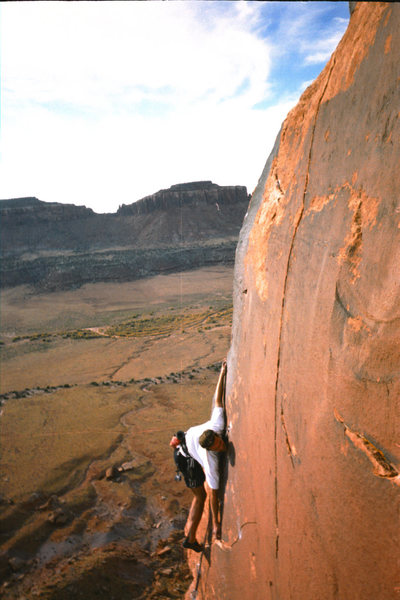 The crux of Learning To Crawl (5.11c) Indian Creek, UT.  Somehow this beta works for me.  Photo by Charles Vernon.