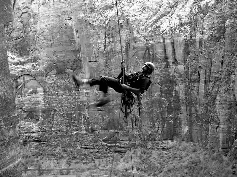Rock Climbing Photo: Photograph of person hanging from thing