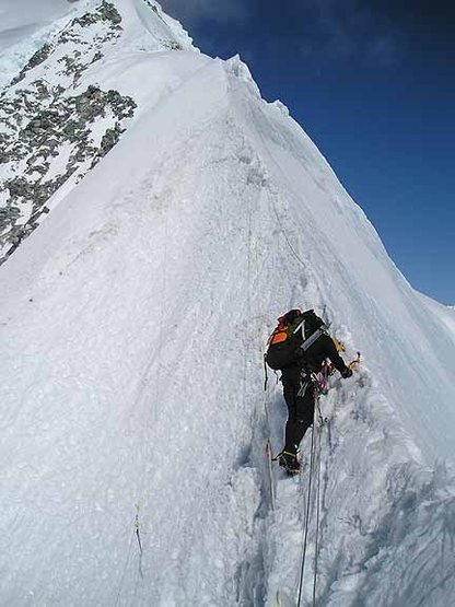 Me leading lower knife edge, Mt. Logan's east ridge in 2004. Photo by Jeff Neri