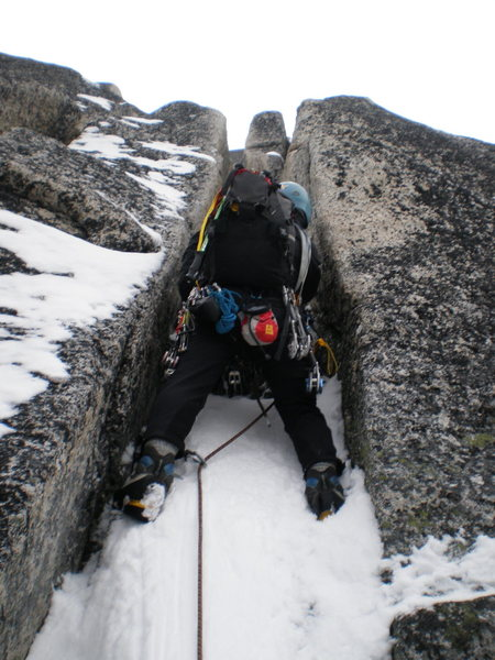 Entering the chimney system on Bug Spire. Note the useless chalk bag.