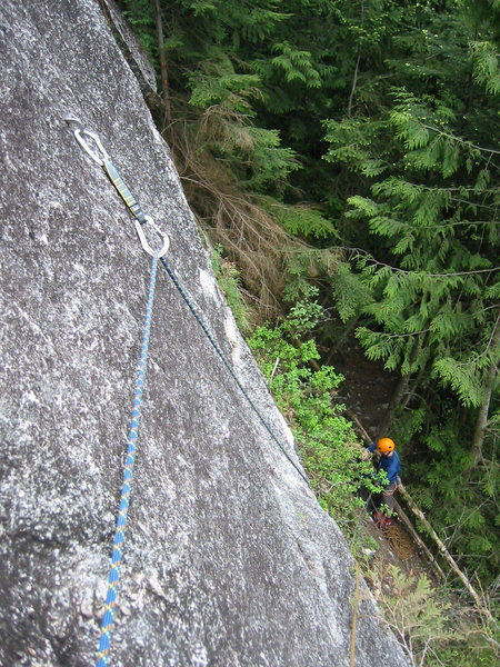 The first pitch of Borderline.  Brad was sorting a rope tangle so I got out the camera.  In the forest, the wall has a cragging atmosphere, but as soon as you're actually on the face, with the Sheriff's Badge above and views all around the Squamish Valley, it suddenly feels like a very big wall.