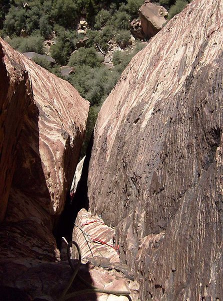 Looking down pitch 2.  The climber is at the top of the offwidth and about to enter the chimney.