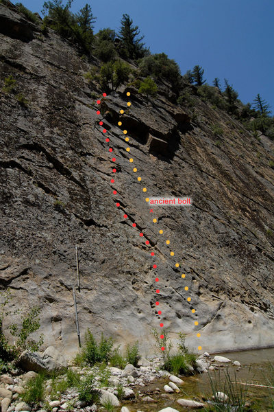 """The line of red dots is a reasonably protected lead.  I believe this to be """"Half Ascent.""""<br> <br> The line of orange dots is a run-out face climb past a sketchy bolt on licheny rock.  I believe this might be """"McTavish."""""""