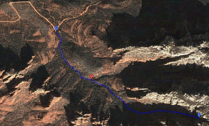 This is a photo of the approach from the pullout off of Schnebly Hill Road to the base of Shangri-La.<br> <br> The red arrow marks a point where you leave the main wash and break off to the right.  This comes just after a large, open, red slickrock area.  Make sure not to miss it!