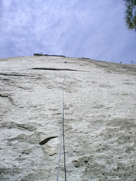 The first pitch, with my back-pack clipped to the anchors. One of the great things about rope-soloing is the chance to climb each pitch twice. This pitch is easiest if led in from the left and meandering to the right after the overlap, which offers more protection. However, the direct route is quite good and very bold.