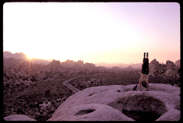 Jodi Levine performs a sunset salutation atop Intersection Rock.