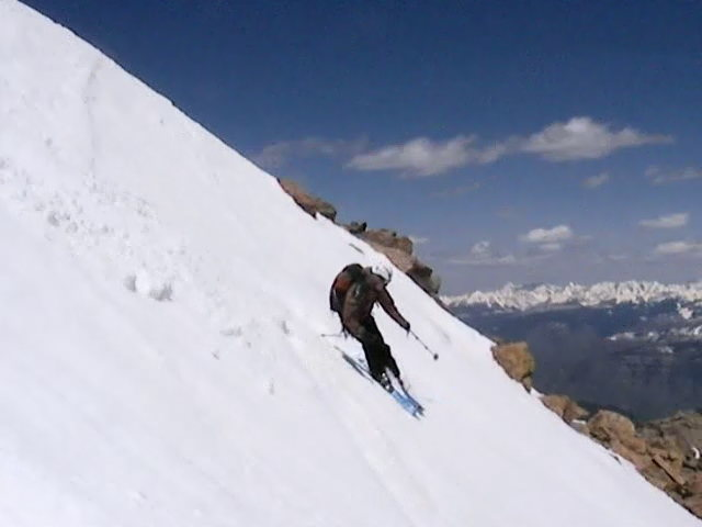 Austin Porzak skiing off the summit of Mount of the Holy Cross