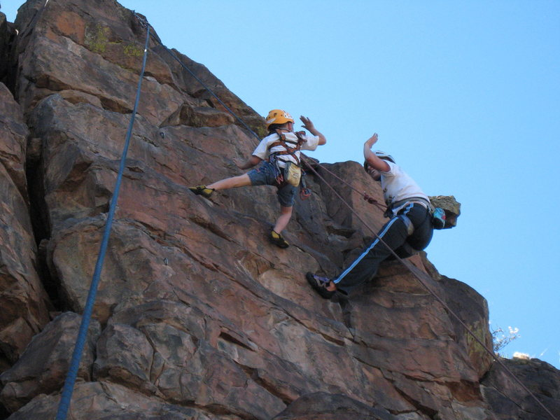 Cody on <em>Once Were Warriors</em> and Amy B. on <em>Pejos Route</em> giving each other a high-five on their way to the top. June 1, 2008.