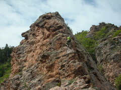 Rock Climbing Photo: A climber approaching the top of the Hat on Pitch ...