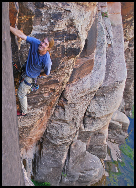 Past the roof and loving the nice splitter crack on Hot Chocolate at Winslow Wall.  Photo by Manny R.