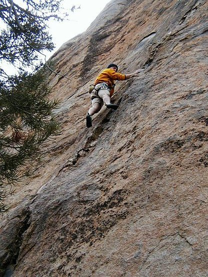 Chuck following Welcome to Planet M.F. (5.10a) with a broken foot, Benton Crags