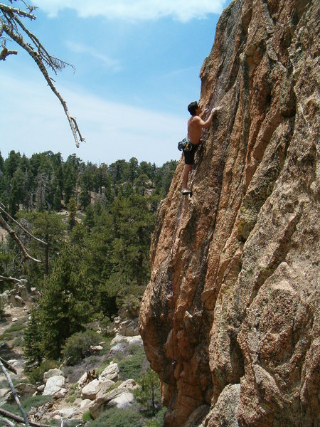 Bryan high above the pines and cruising on Jet Blue (5.11a), Crafts Peak