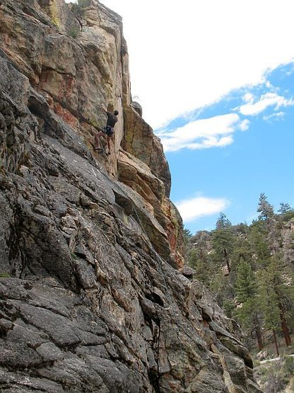 Starting up the steep arete on Out of Sight (5.10b), 8000 Foot Crag
