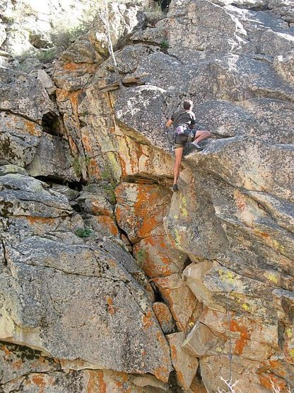 Pulling onto the finishing slab of P.H.D. (5.10c), 8000 Foot Crag
