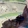 Sarah relaxing at our belay at the top of pitch one on Moscow, 5.6, Smith Rock. <br> Fun, shady climb on mostly good rock. Mostly easy to protect. We did the climb as 3 pitches as I needed to use some gear for the belay anchors.
