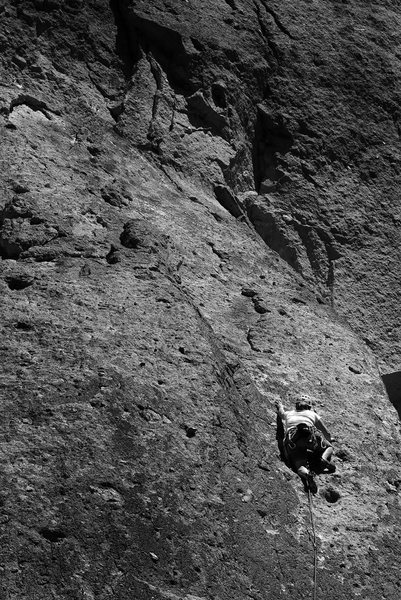 Sarah on lead reaching for another great big golf-ball knob, 3/4 of the way up Dancer, 5.7, Smith Rock.