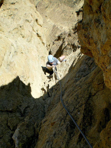 Jon following up the end of the 5.4 - 5.5-ish loose & run-out, but fun, corner groove for pitch 2 of the Cave Route. Photo take from belay bolt anchors on the shoulder - a nice, airy belay ledge.