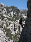 Rock Climbing Photo: Chaz at the top of Quest for Fire, looking across ...