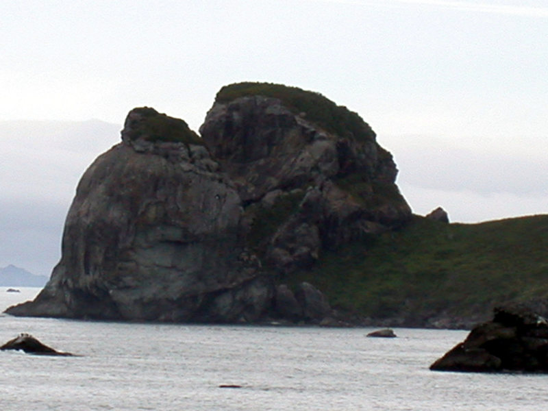 The south face of Footsteps Rock as viewed from Highway 101 when approaching from the south.