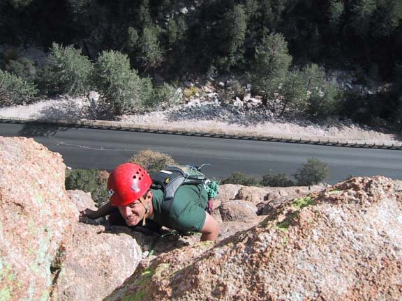 Kelly Mathis topping out on the Standard Route.  Lemmon Highway visible below.