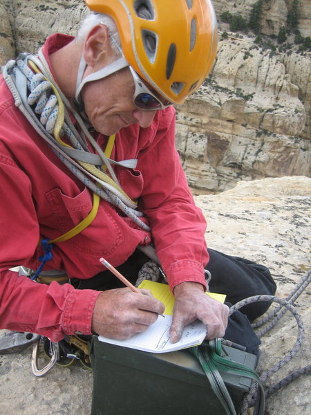 James G. signing the summit register he brought up for the climb.