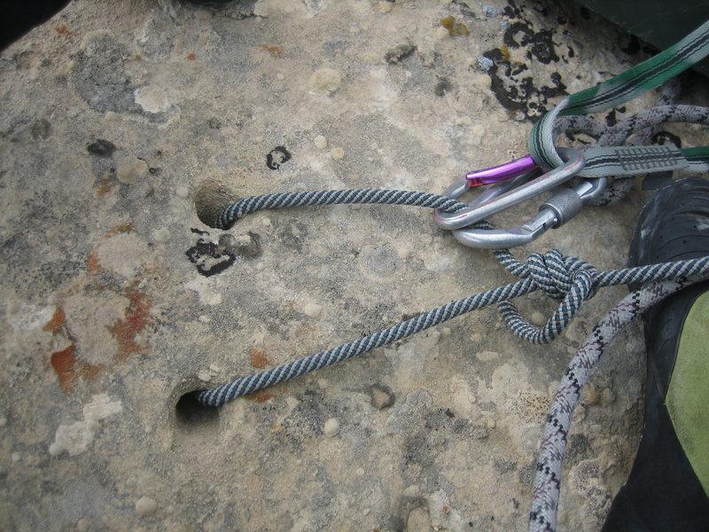 V-thread anchors on the summit.