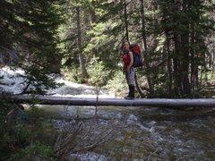 Rock Climbing Photo: She's still happy.  One of the 3 creek crossings w...
