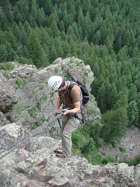 Rock Climbing Photo: Steve rappelling down the face.