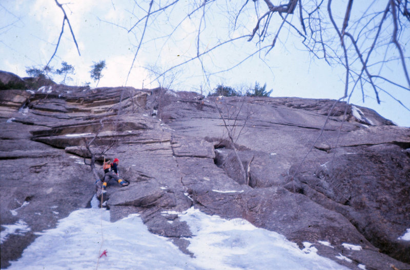 Toe Crack/Standard Route: Cathedral Ledge January 1975<br> <br> Ice is nice@SEMICOLON@ verglas isn't. Doug Fosdick and I each had a go at leading the ice-choked crack to the right of the tree but the verglas was too thin for crampons and the rock was too icy for vibram. We bailed after several attempts and returned to North Conway in disgrace.