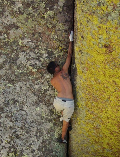 Micah bouldering the classic handcrack: Hair of the dog.