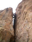 Rock Climbing Photo: Jason Schrack works through the chimney on pitch 3...