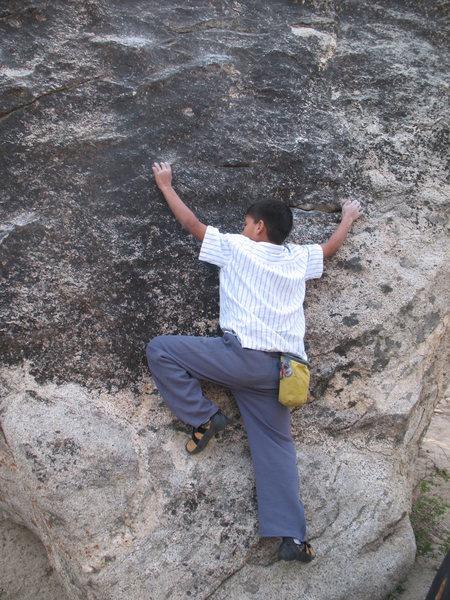 Rock Climbing Photo: Jeffy starting up the Slab Problem (V1), Tramway.