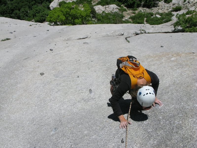 "Maura climbing the slab to the belay after ""The Hook""."