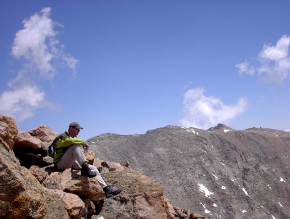 Sitting on rock outcrop at top of Mt Bierstadt.