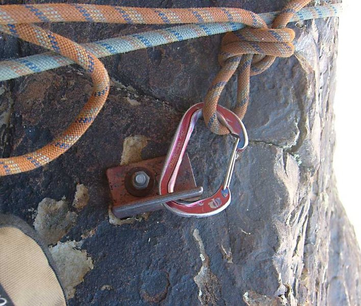 Mystery bolt: at the top of the third pitch, we found bail slings on this nicely placed old bolt.