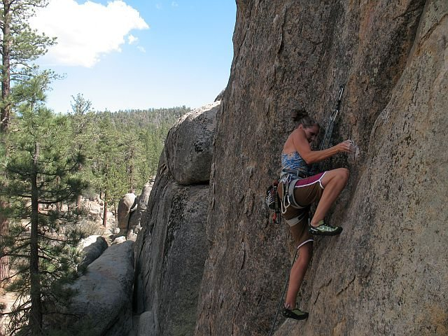 Susan discovering the key to being a Slacker (5.10c), Holcomb Valley Pinnacles