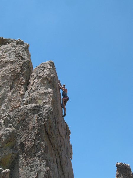Making the last moves to the anchors on Tombstone Shadow (5.10b), Holcomb Valley Pinnacles.