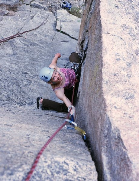 Friend and climbing partner Kat A. follows 'Cosmosis' (sandbag 5.9) on Bell Buttress in Boulder Canyon. Photo by Tony Bubb, 6/08.