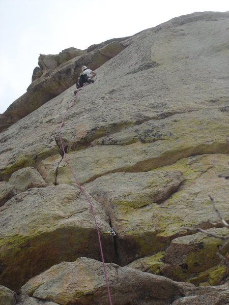 Jon moving his way towards the roof crux.