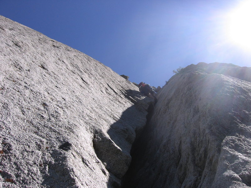 Hoskins out of the chimney and leaning into the lieback - P2: EllsWorth McQuarry Route<br>