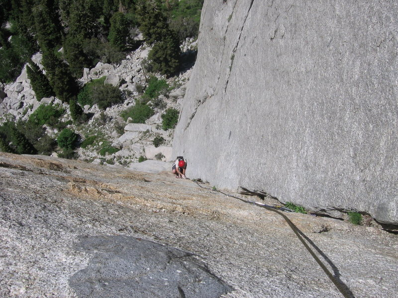 Hoskins starting the 3rd pitch, still exposed! - P3: EllsWorth McQuarry Route<br>