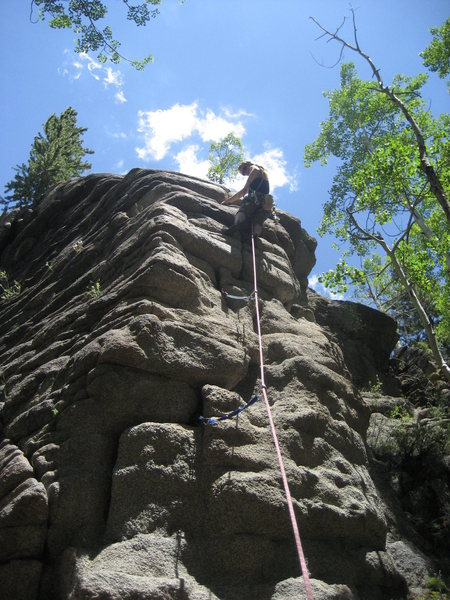 C. Love reaches for a cam on her 1st traditional lead climb.