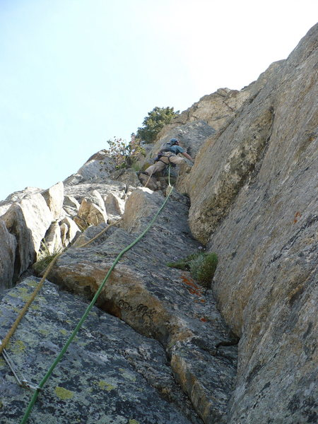 Climbing the 5.6/7 dihedral on our 3rd pitch. Guides Wall, Storm Point, GTNP, WY.