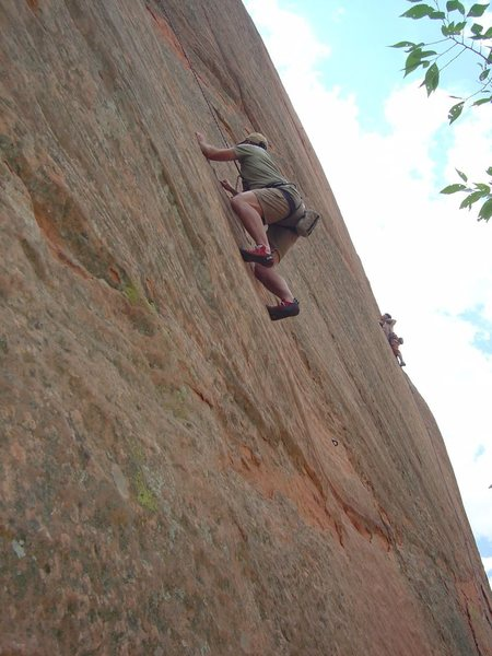 Ramsey Ross ascending a 5.10b on east wall.