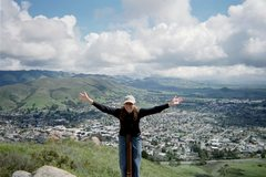 Rock Climbing Photo: Deanna atop Cerro San Luis (aka Madonna Hill) over...