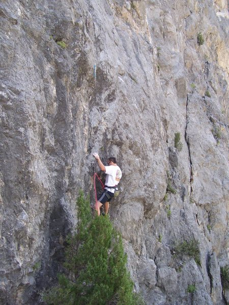 Rock Climbing Photo: Grabbing the neat sloper pinch at the second bolt.
